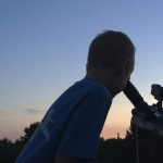 Boy with telescope and moon